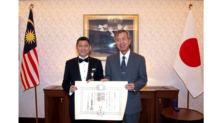A great honour: Lee San (left) posing with Japan's ambassador to Malaysia Dr Makio Miyagawa after he was conferred 'The Order of The Rising Sun' by the ambassador on behalf of the Emperor of Japan.