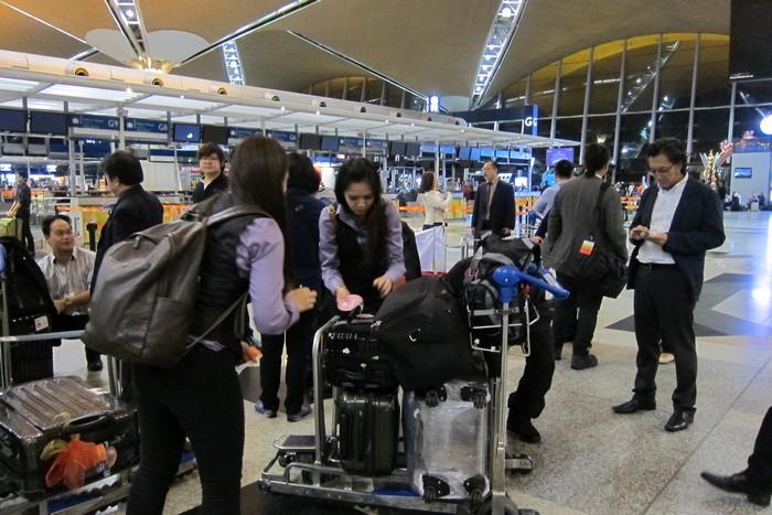 客人办完登机手续,领队也各就各位。