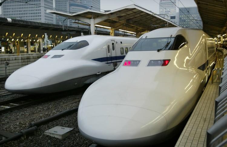 "JAPAN'S BULLET TRAIN, OR THE ""SHINKANSEN"" AT TOKYO STATION."