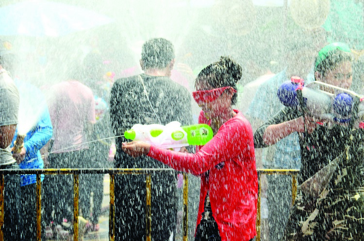 CHIANG MAI, THAILAND - APRIL 15 : People celebrating Songkran or
