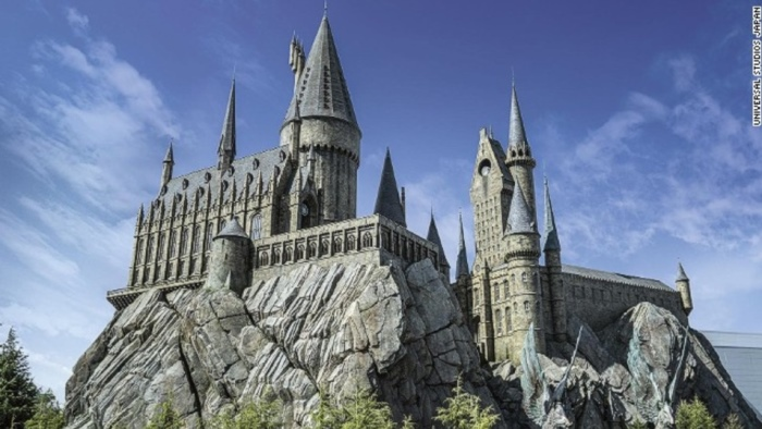 """Inside of the replica of Hogwarts School of Witchcraft and Wizardry, visitors will find the signature """"Harry Potter and the Forbidden Journey"""" ride, a flight simulator filled with special effects."""