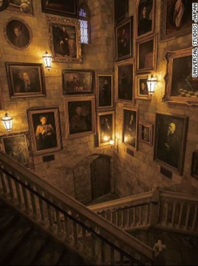"""Just like in the films, portraits line the walls of Hogwarts Castle in the Wizarding World of Harry Potter. Visitors walk through the gallery to get to the """"Harry Potter and the Forbidden Journey"""" ride."""