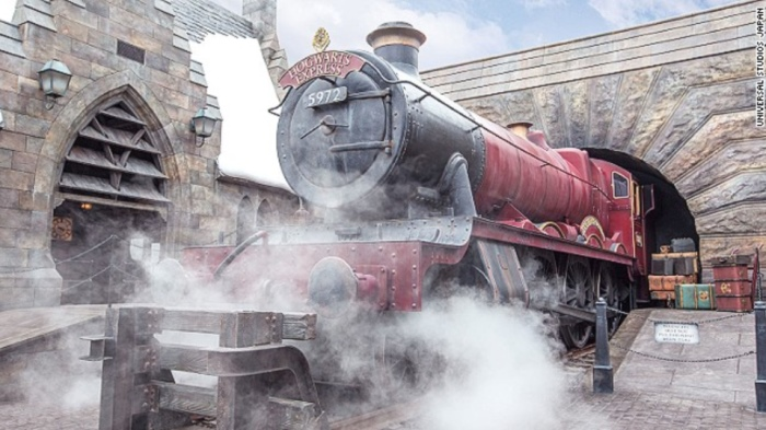 The scarlet Hogwarts Express steam engine is on display at Hogsmeade Station. It's the first thing visitors see after passing through the arch into Hogsmeade.
