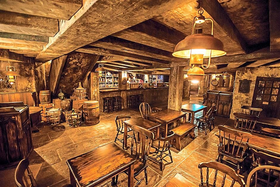 The Three Broomsticks tavern frequented by students and teachers of Hogwarts from the Harry Potter series.