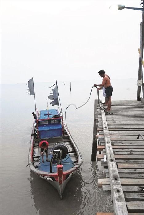 傍晚时分,你可在情人桥看见渔船归来。